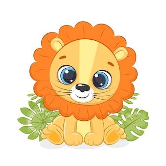 Il piccolo leone sveglio è seduto davanti al fogliame tropicale