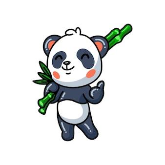 Simpatico cartone animato panda che tiene bambù