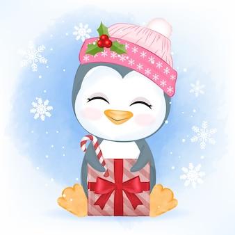 Piccolo pinguino sveglio con confezione regalo, illustrazione di natale.