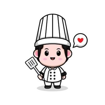 Simpatico chef maschio che tiene l'illustrazione della mascotte del fumetto della spatola