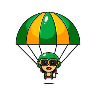Simpatico personaggio scimmia design a tema giocando un paracadute