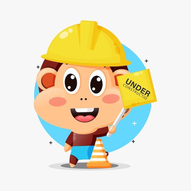 Mascotte scimmia carina che lavora nella costruzione