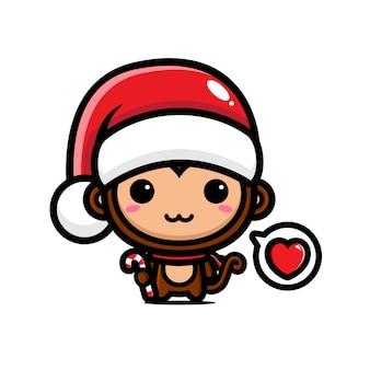 Scimmia carina che indossa il cappello di babbo natale