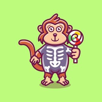 Scimmia carina che indossa il costume di halloween scheletro e trasporta lecca-lecca