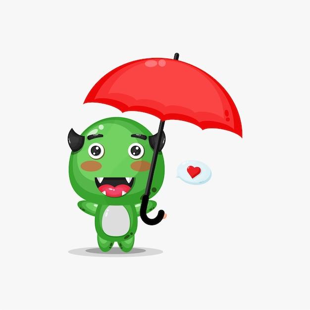 Mostro carino che porta un ombrello