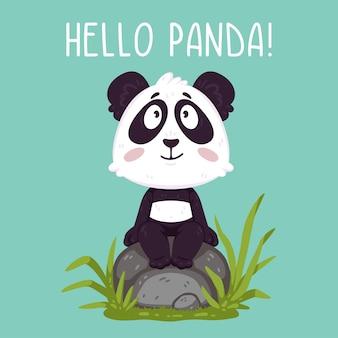 Simpatico orsetto panda seduto sulla roccia