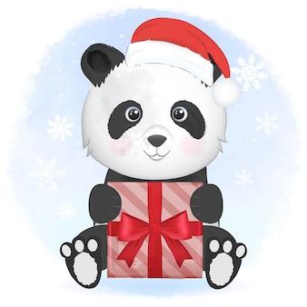 Panda carino con confezione regalo in inverno e illustrazione di natale.