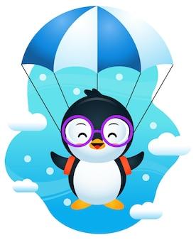 Pinguino sveglio che vola con il paracadute