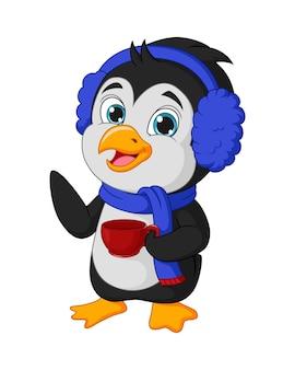 Pinguino carino che tiene una tazza rossa