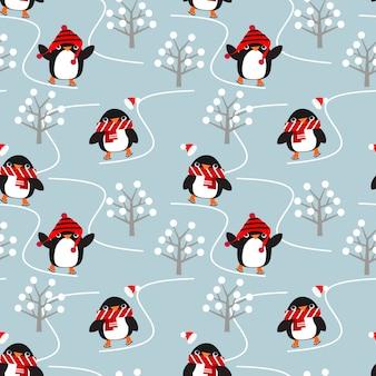 Simpatici pinguini giocano a pattinare sul ghiaccio nell'inverno natalizio.