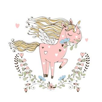 Unicorno rosa carino con ali in una cornice di fiori.