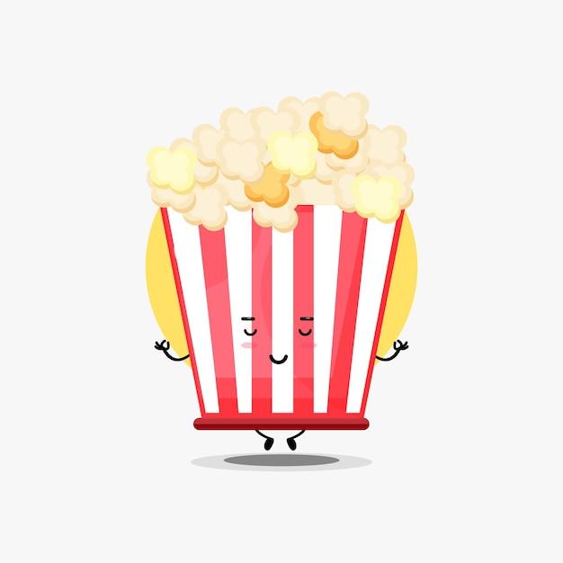 Simpatico personaggio di popcorn che medita in posa yoga