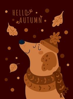 Cucciolo di cane sveglio in cappello e sciarpa. ciao autunno