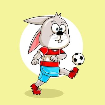 Cartone animato carino coniglio giocando a calcio illustrazione