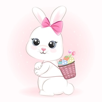 Coniglio carino e uova di pasqua nel cestino, il giorno di pasqua concetto
