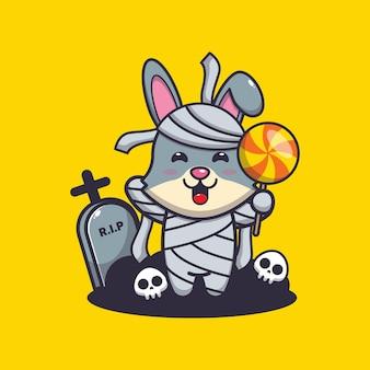 Simpatica mummia di coniglio che tiene caramelle simpatica illustrazione di cartone animato di halloween