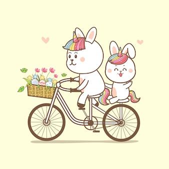 Unicorno carino conigli in sella a una bicicletta