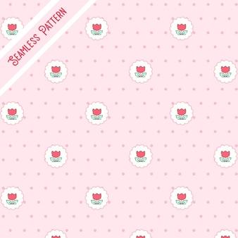 Simpatici fiori rossi e punti su un modello senza cuciture di sfondo rosa