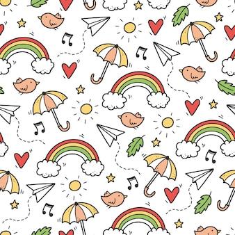 Simpatico motivo doodle senza soluzione di continuità con nuvola, arcobaleno, ombrello, sole, elemento stella. stile per bambini linea disegnata a mano. illustrazione di vettore del fondo di scarabocchio.