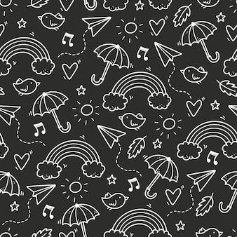 Simpatico motivo doodle senza soluzione di continuità con nuvola, arcobaleno, ombrello, sole, elemento stella. stile per bambini linea disegnata a mano. illustrazione di vettore del fondo della lavagna di scarabocchio.