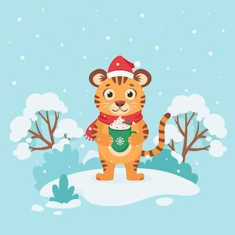 La simpatica tigre augura buon natale e felice anno nuovo 2022 su sfondo invernale anno della tigre