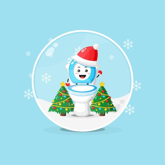 Tazza da toilette carina che indossa un cappello di natale in un globo di neve