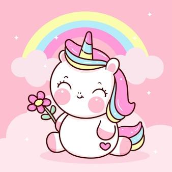 Simpatico cartone animato unicorno con arcobaleno che tiene animale kawaii fiore estivo