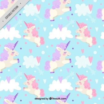 Carino unicorno tra modello nuvole