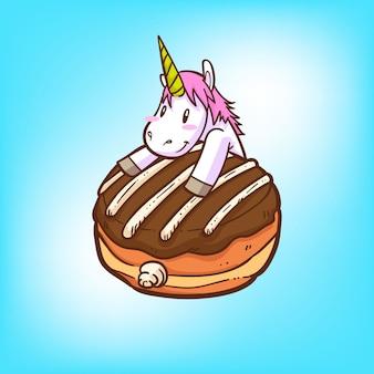 Carino unicorno e ciambelle