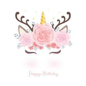 Testa di unicorno carino con corona di fiori per il compleanno.
