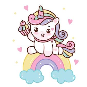 Unicorno carino che tiene cupcake su arcobaleno