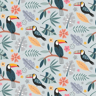 Simpatico motivo vettoriale senza soluzione di continuità con uccelli esotici pappagallo tucano e piante tropicali