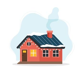 Simpatica casa invernale decorata con luci