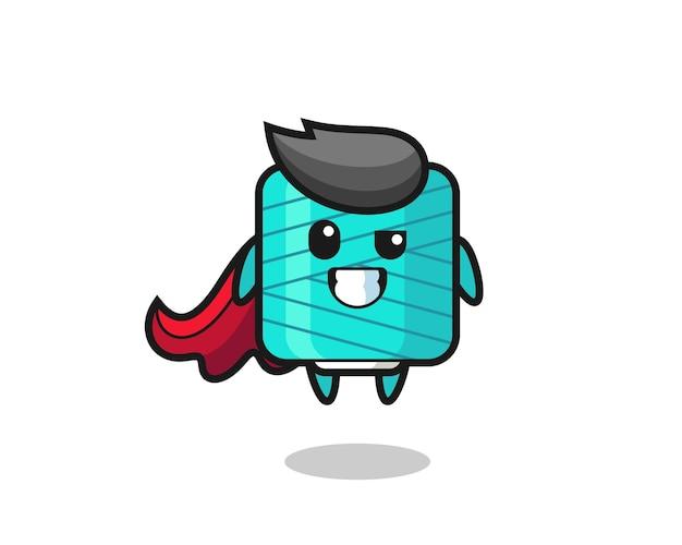 Il simpatico personaggio della bobina di filato come un supereroe volante, design in stile carino per maglietta, adesivo, elemento logo