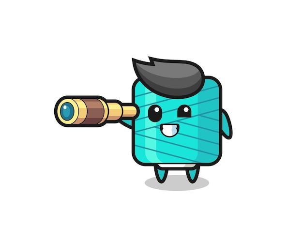 Il simpatico personaggio della bobina di filato tiene in mano un vecchio telescopio, un design in stile carino per maglietta, adesivo, elemento logo