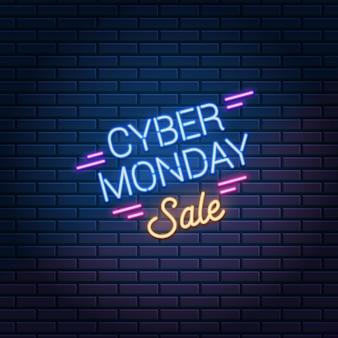 Insegna al neon di cyber monday sale sul muro di mattoni scuri
