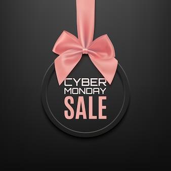 Bandiera rotonda di vendita di cyber monday con nastro rosa e fiocco, su sfondo nero. brochure o modello di banner.