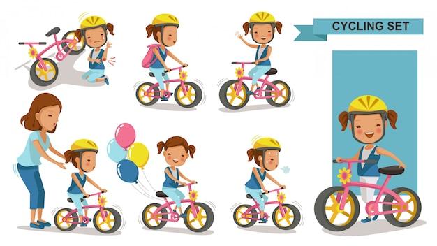 Bambina in bicicletta. madre che insegna alla figlia. bambino in sella a una bicicletta urbana nel casco. infortunio alla prima gamba e infortunio alla bici. giocare al parco giochi.