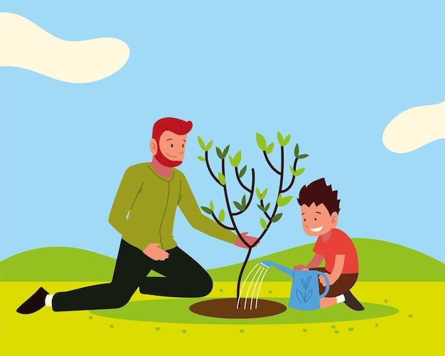 Figlio di papà che pianta e innaffia l'albero