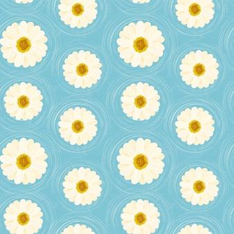 Fiori di margherite motivo floreale senza soluzione di continuità su sfondo blu