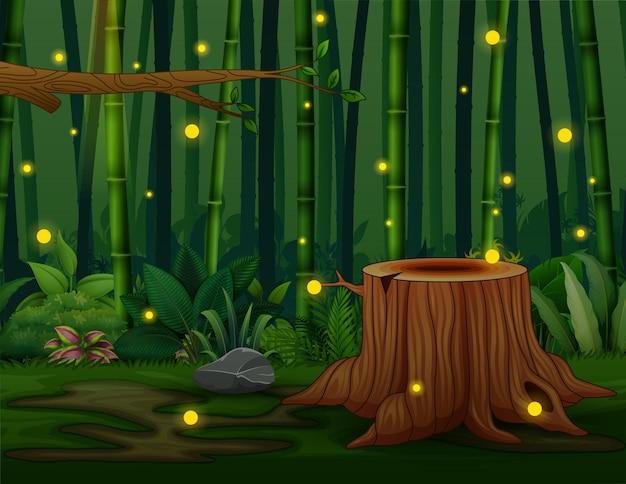 Un paesaggio di foresta di bambù scuro con lucciole