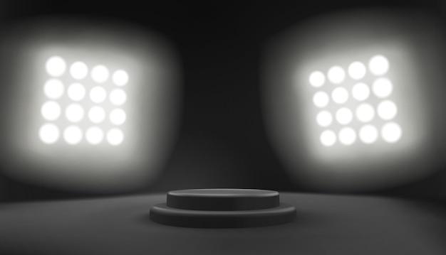 Scena del podio scuro con riflettori dello stadio