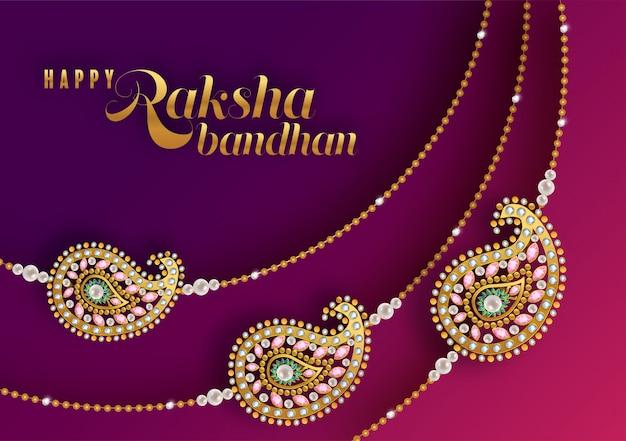 Rakhi decorato per il festival indiano raksha bandhan, festival indiano con oro e cristalli su fondo di colore di carta.