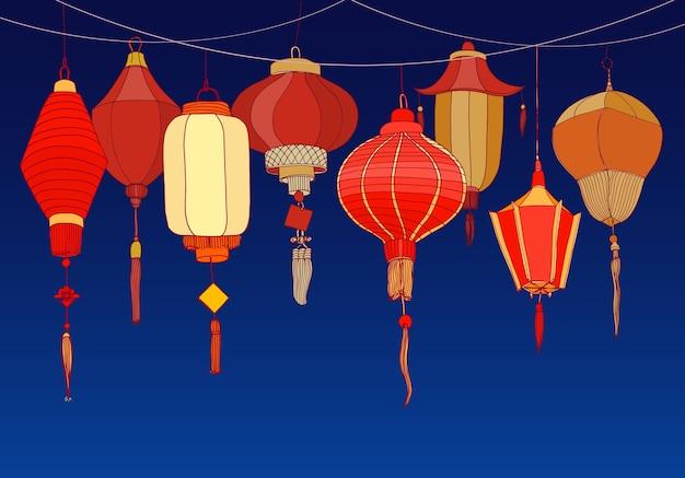 Sfondo decorativo con lanterne cinesi di carta rossa di varie forme e dimensioni