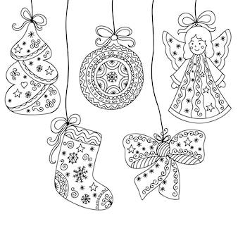 Decorazioni festive decorative con fiocchi, albero di natale, angelo, palline e punta.