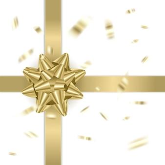 Fiocco decorativo dorato su sfondo bianco decorazione per le vacanze di natale e capodanno