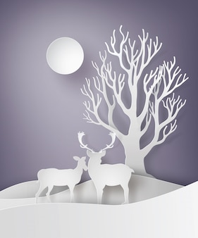 Coppia di cervi in piedi insieme in un campo di neve