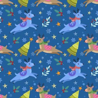 Cervo con albero di natale e pianta sul modello senza cuciture blu.