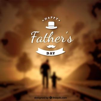 Sfocato sfondo di padre e figlio