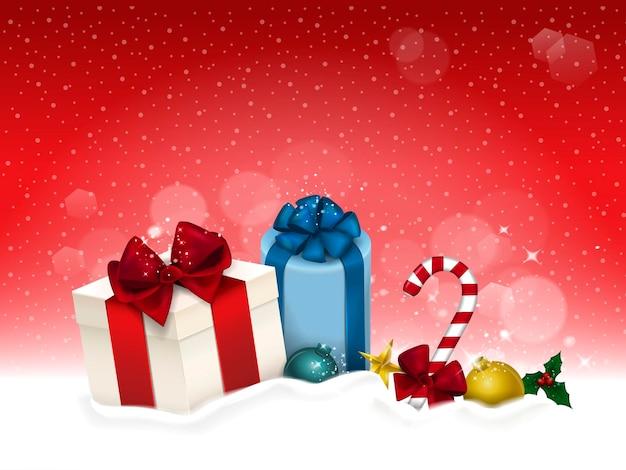 Delicati regali di natale isolati sul campo di neve